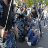 Violence in Moscow as Riot Police Squeeze Sanctioned Anti-Putin Protest